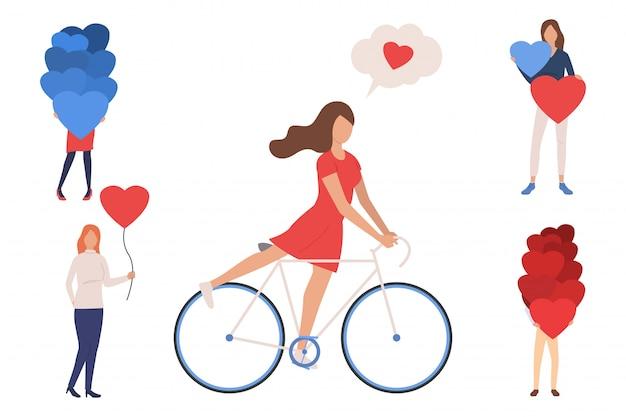Colección de mujeres jóvenes con globos en forma de corazón.