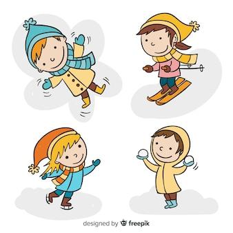 Colección de niños en invierno dibujados a mano