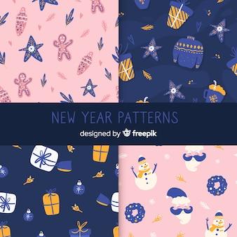 Colección patrones año nuevo elementos invierno