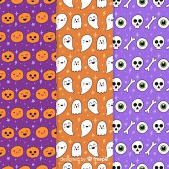 Colección de patrones de fiesta de halloween con calabazas y calaveras