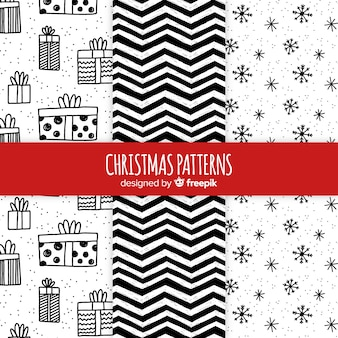 Colección de patrones navideños en blanco y negro dibujados a mano