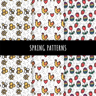 Colección de patrones de primavera dibujados a mano con abejas y pollos