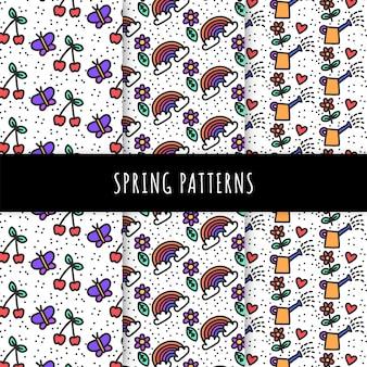 Colección de patrones de primavera dibujados a mano con cerezas y mariposas