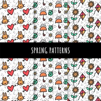 Colección de patrones de primavera dibujados a mano con sombrillas y cometas