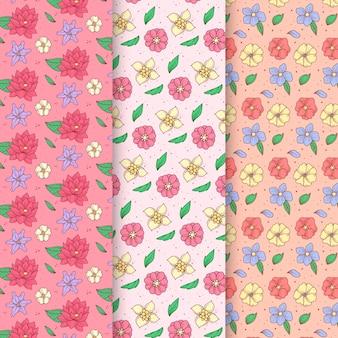 Colección de patrones de primavera dibujados a mano con una variedad de flores