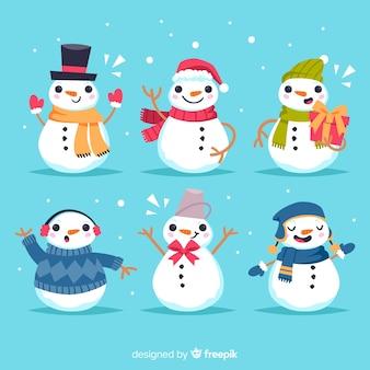 Colección de personaje de muñeco de nieve en diseño plano