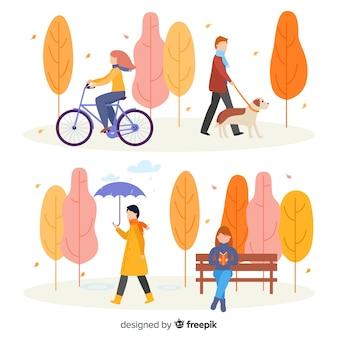 Colección de personas en el parque en otoño
