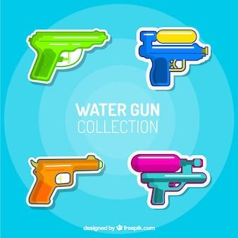 Colección de pistolas de agua coloridas en estilo plano
