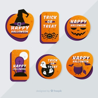 Colección plana de etiquetas y distintivos de halloween sobre fondo gris