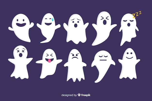 Colección plana de fantasmas de halloween sobre fondo violeta