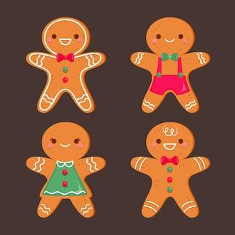 Colección plana de galletas de hombre de pan de jengibre sobre fondo oscuro