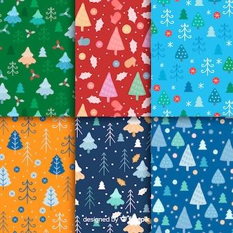 Colección plana de patrones de navidad con árboles