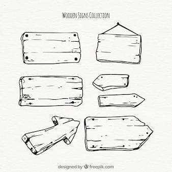 Colección de señales de madera dibujadas a mano