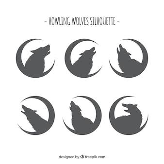 Colección de siluetas de lobos con luna