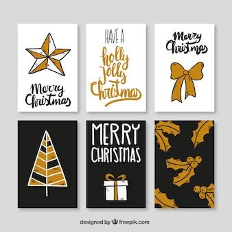 Colección de tarjetas de navidad doradas dibujadas a mano