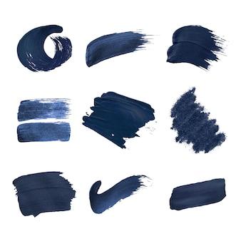 Colección de trazos de pincel azul marino.
