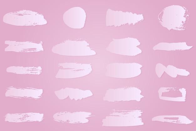 Colección de trazos de pincel de tinta blanca degradada