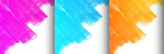 Colección de tres vectores de fondo de diseño de trazo de pincel colorido