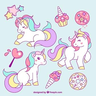 Colección de unicornios dibujados a mano con elemenos