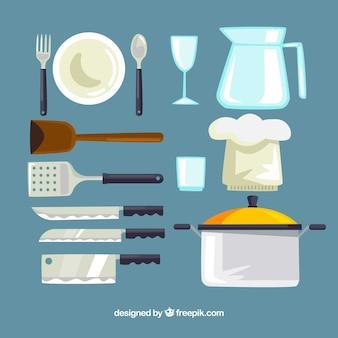 Colección de utensilios de cocina y gorro de chef