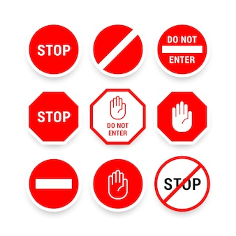 Colección de varias señales de alto en rojo y blanco para el conductor