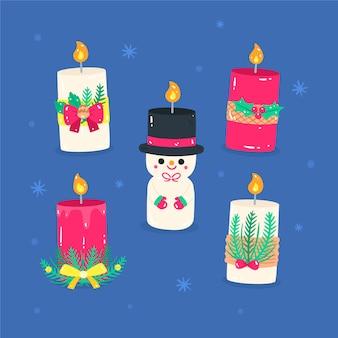 Colección de velas de navidad dibujadas a mano sobre fondo azul