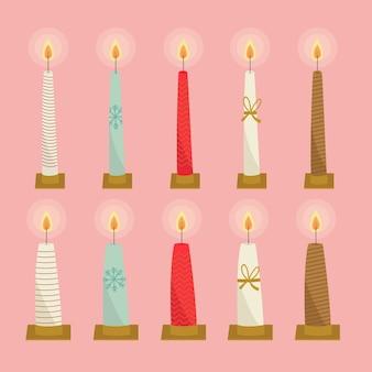 Colección de velas de navidad dibujadas a mano sobre fondo rosa