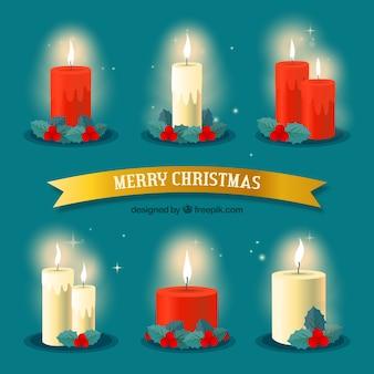 Colección de velas navideñas encendidas