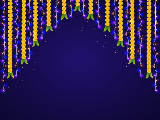 Colgantes luces de colores y decoraciones de flores para celebraciones felices de diwali.