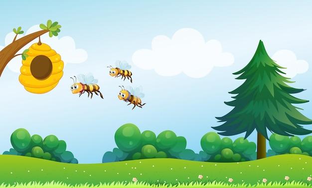 Una colmena sobre la colina con tres abejas.