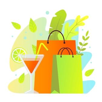 Coloridas bolsas de papel de compras y copa de cóctel