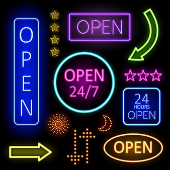 Coloridas luces de neón de letreros abiertos para establecimiento n fondo negro.