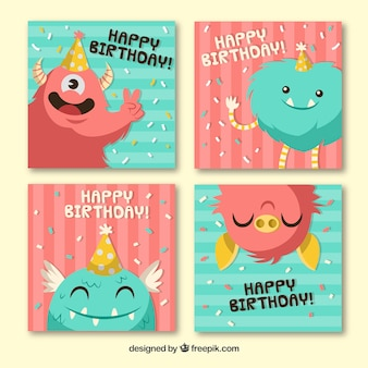 Coloridas tarjetas de cumpleaños dibujadas a mano con monstruos lindos