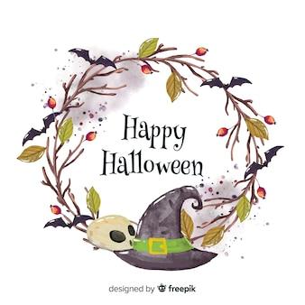 Colorido fondo acuarela de halloween con sombrero de bruja y calavera