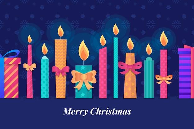 Colorido fondo de velas de navidad en diseño plano