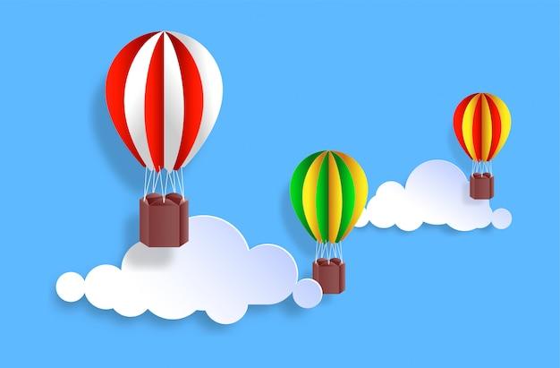 Coloridos globos aerostáticos en la nube con estilo de corte de papel