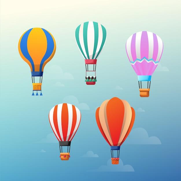 Coloridos globos de aire caliente en el cielo azul.