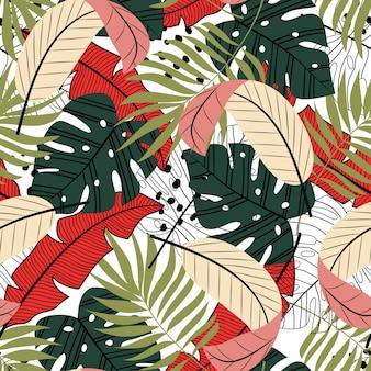 Coloridos patrones sin fisuras, hojas tropicales y plantas sobre fondo blanco.