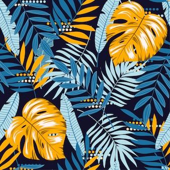 Coloridos patrones sin fisuras con hojas tropicales sobre fondo oscuro