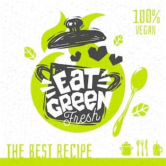 Coma sopa verde logo del corazón del amor recetas orgánicas frescas cien por ciento veganas. dibujado a mano.