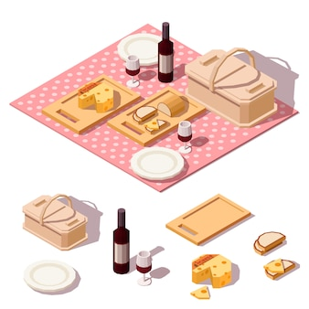 Comida de picnic con cesta, botella de vino, queso, pan y tela.