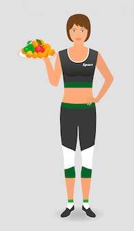 Comida sana para una dieta. atleta mujer sostenga una bandeja con frutas.