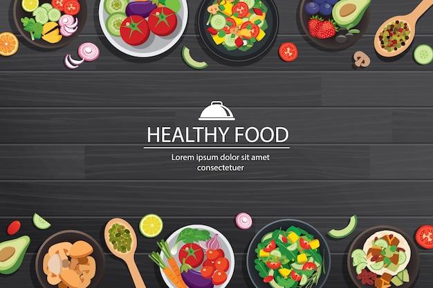 Comida sana con ingredientes en la mesa de madera oscura.