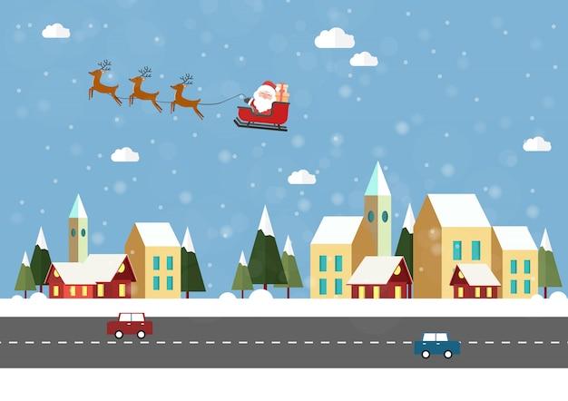 Comienza la temporada de invierno. pueblo con árbol de navidad navidad santa claus volando en el cielo.