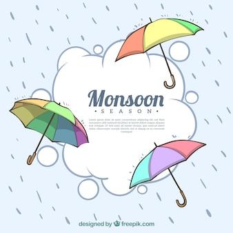 Composición adorable de la época del monzón con paraguas