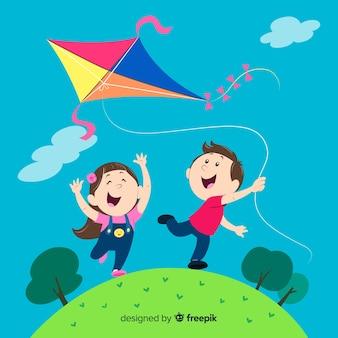 Composición de niños volando cometa de papel