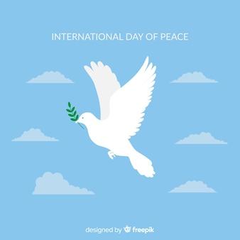 Composición del día de la paz con paloma blanca de diseño plano