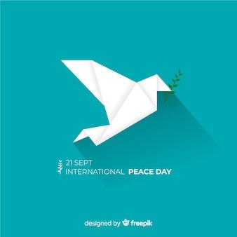 Composición del día de la paz con paloma blanca de origami