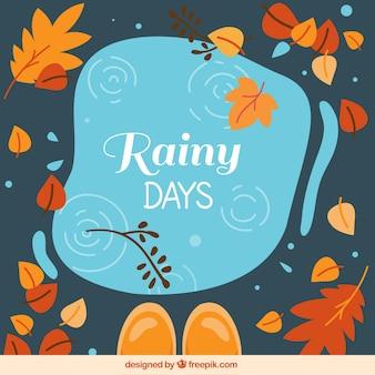 Composición divertida con lluvia y hojas otoñales