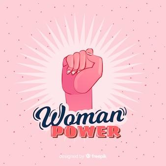 Composición feminista con puño dibujado a mano
